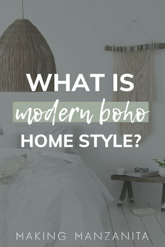 low bed with white bedding and wooden table next to it with white plank flooring with basket pendant light and macrame woven wall hangin on wall with text overlay that says what is modern boho home style?