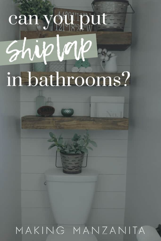 shows a modern boho toilet area in bathroom with horizontal white shiplap on wall and wood floating shelves in background with overlay text that says can you put shiplap in bathrooms?
