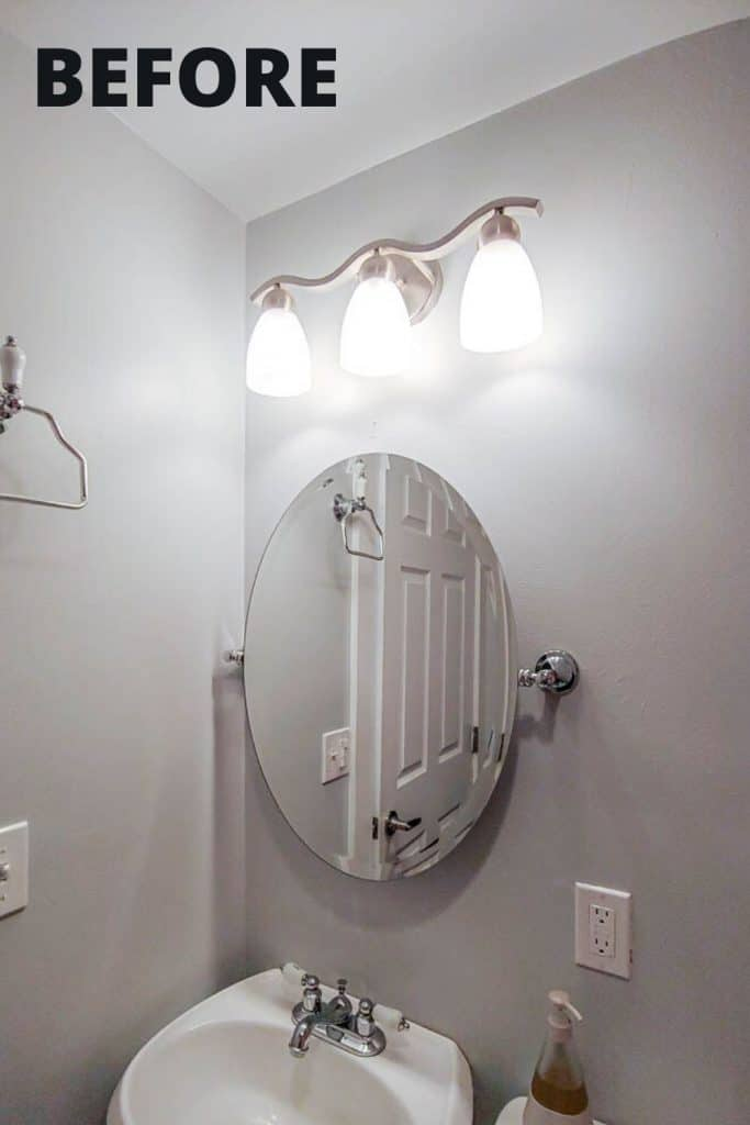 shows a white bathroom with a white sink and large oval mirror and outdated vanity lighting with overlay text that says before