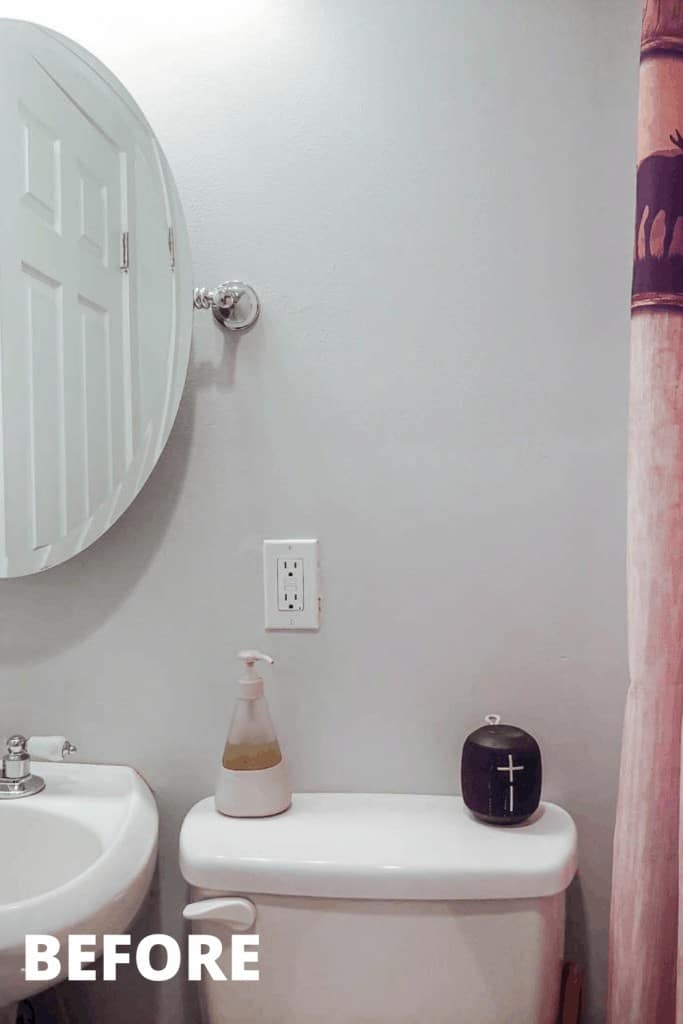shows an up close picture white bathroom with a cabin themed rustic shower curtain and rug with white tile and sink with overlay text that says before