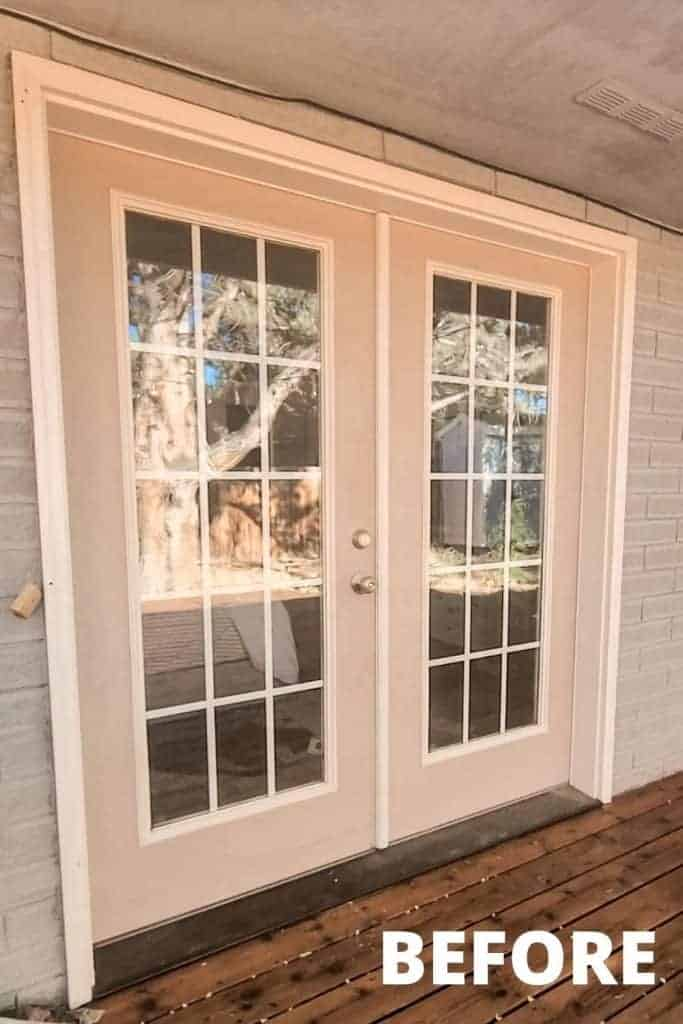 shows a before picture of a gray house and tan french doors