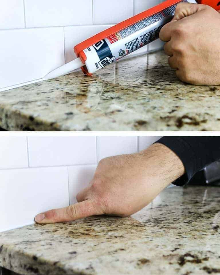 shows a process of squeezing some caulk in a kitchen counter at the base of backsplash and then using a finger to smooth wipe off the excess