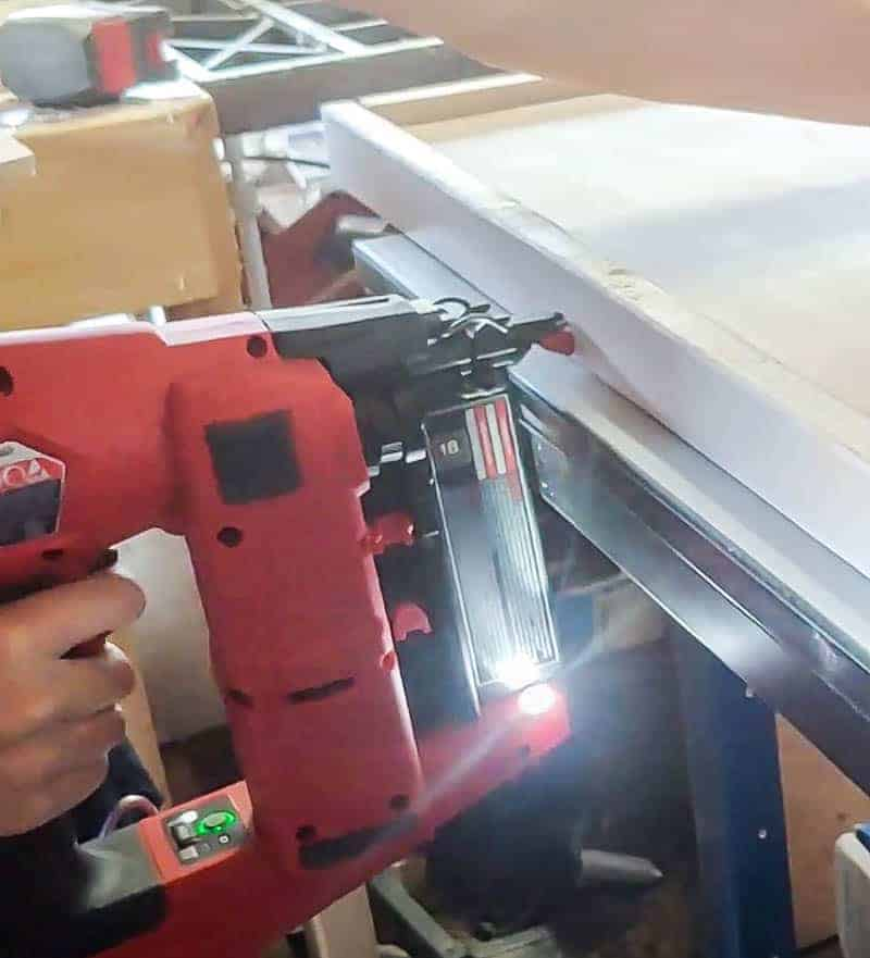 shows the frame being nailed together on the DIY wall art with a brad nailer