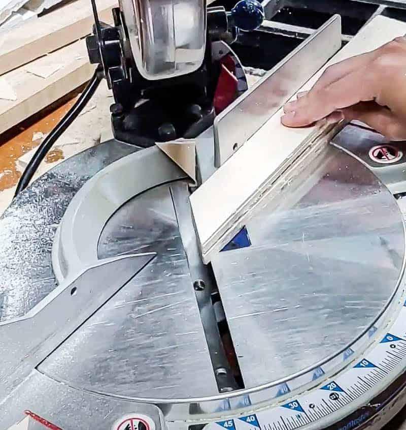 shows a table saw cutting wood shims at a diagonal