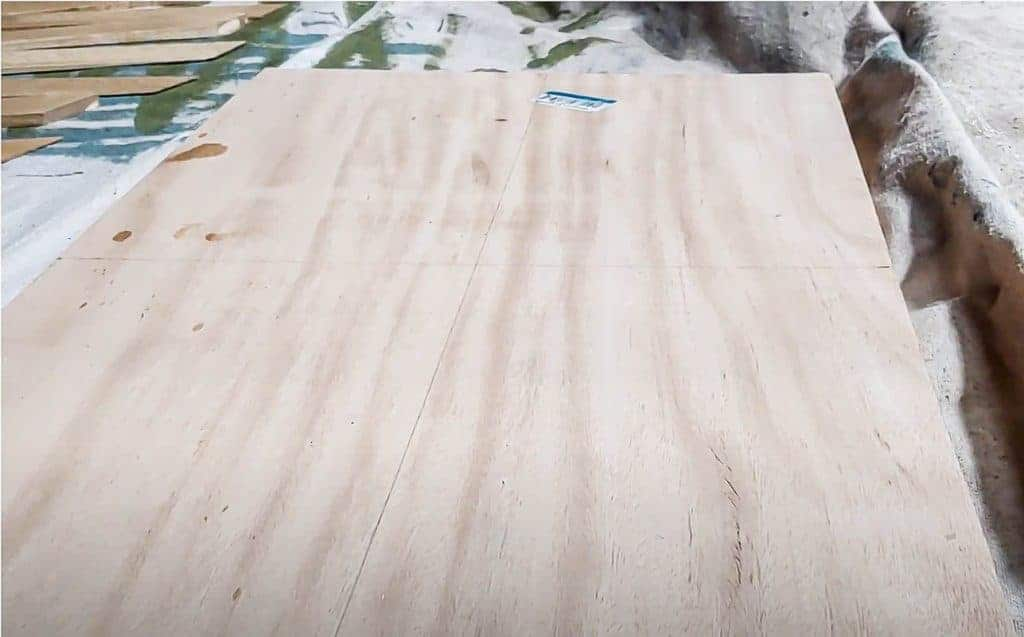 shows a piece of plywood on a blanket