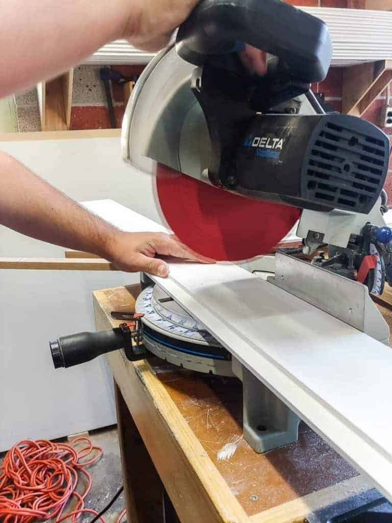 Using a miter saw to cut shiplap planks