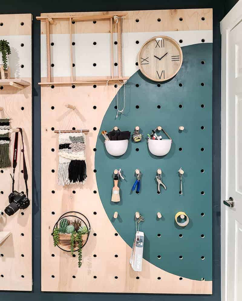 Straight on shot of styled pegboard with items