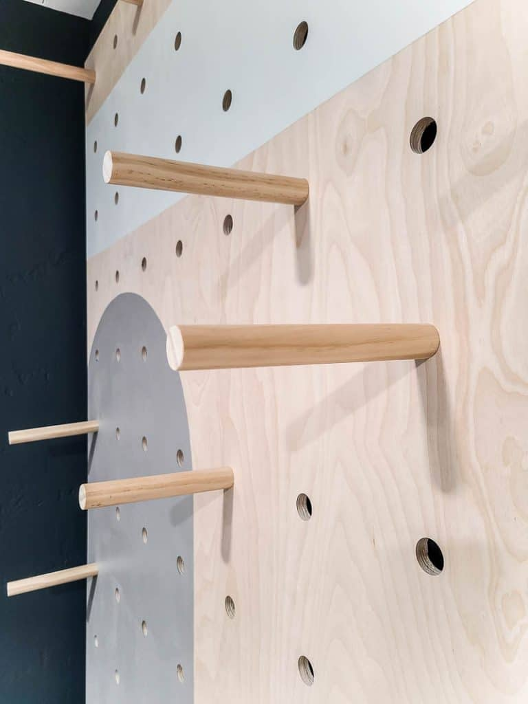 Installing dowels into plywood storage wall
