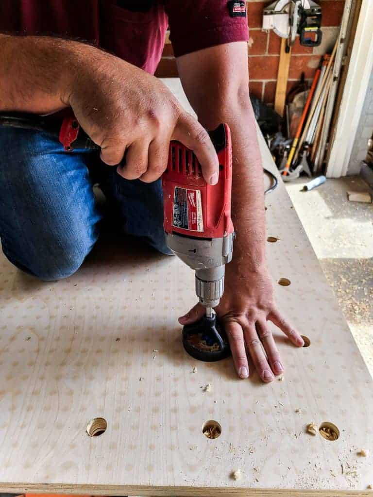 Using drill guide for pegboard holes