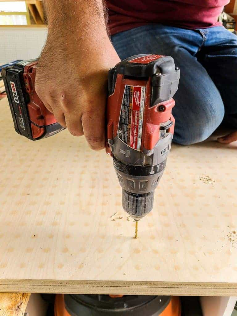 Drilling pilot holes in pegboard