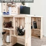 shows angled view of wood crate desk with a computer and wood dole wall behind it with overlay text that says easy DIY desk, cheap and easy to make