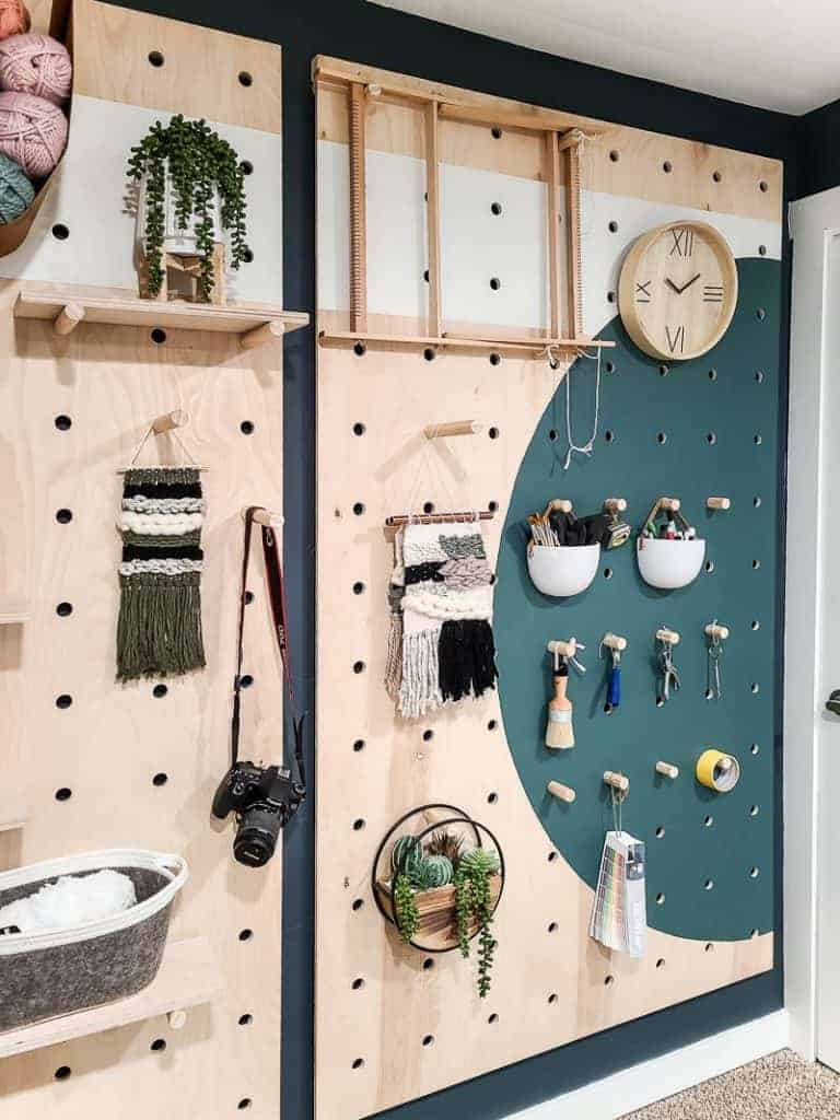 Angled shot of styled pegboard wall with craft supplies