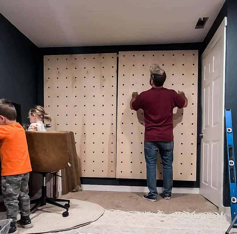 Hanging pegboard on wall