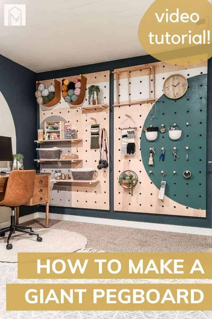 Painted pegboard wall with items stored and hanging with overlay text that says video tutorial and how to make a giant pegboard