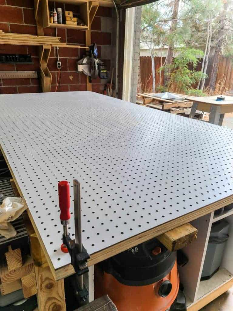 Pegboard panel and plywood clamped together