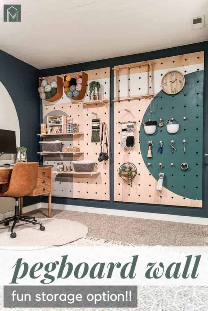 Painted pegboard wall with items stored and hanging with overlay text that says pegboard wall: Fun storage option