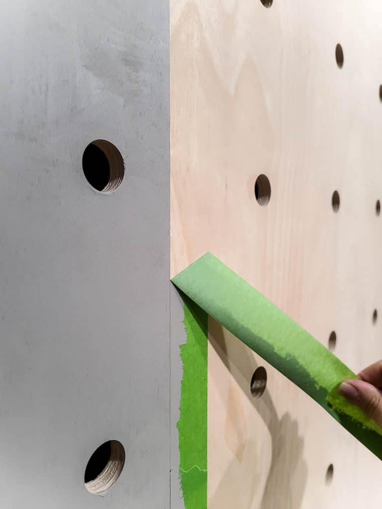 Removing painter's tape from pegboard