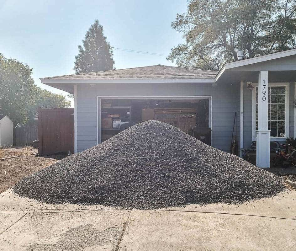 Large pile of 3/4 minus gravel in driveway