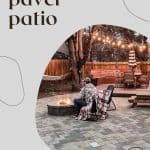 paver patio with herringbone pattern with fire pit with chair next to fire pit and man sitting in chair warming his hands with text overlay that says DIY paver patio