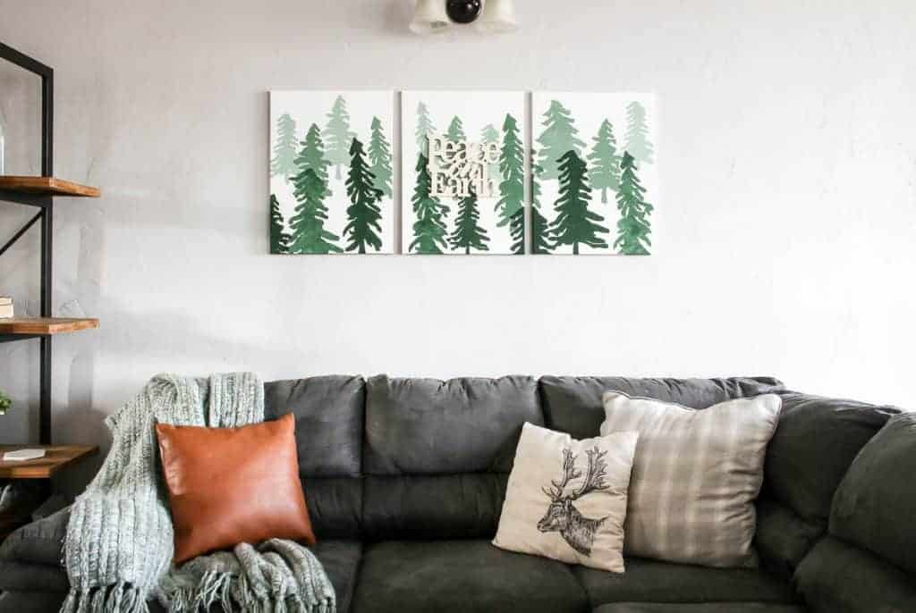 shows the ombre Christmas wall sign above a gray couch