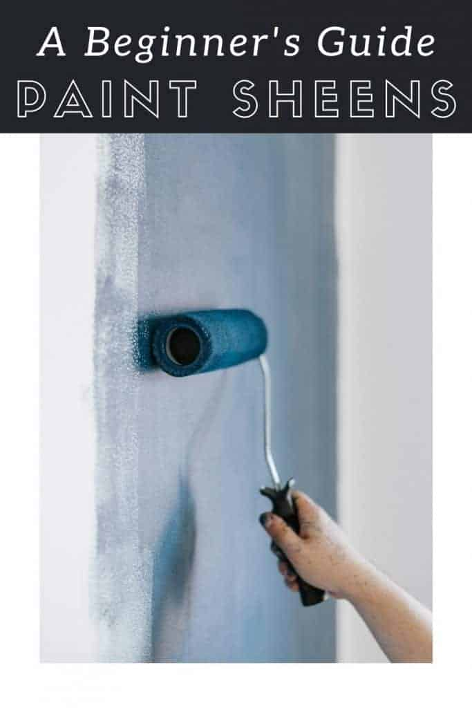 Dark blue paint being rolled onto an interior wall with text overlay that says a beginner's guide paint sheens