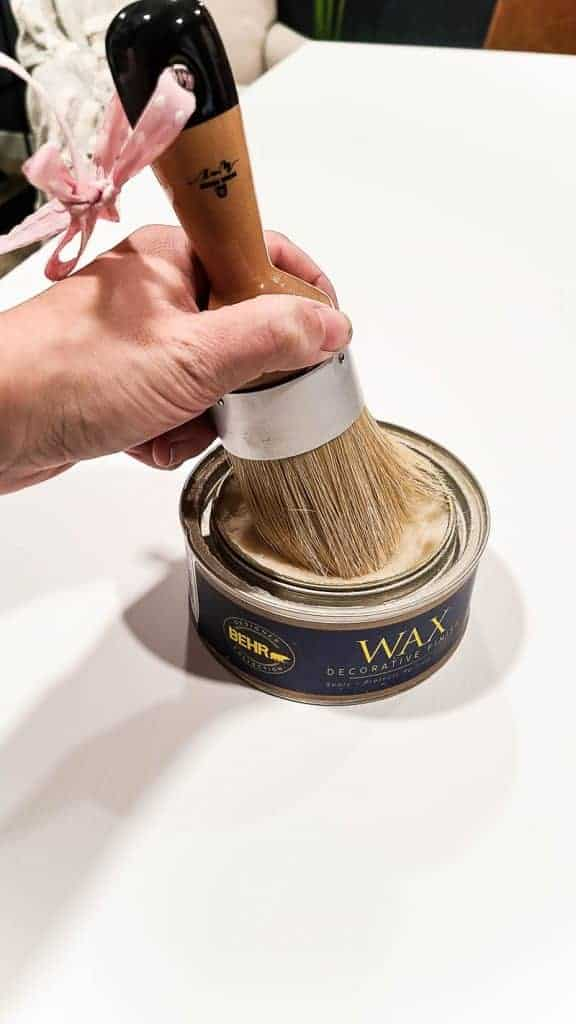 shows a wax can and brush