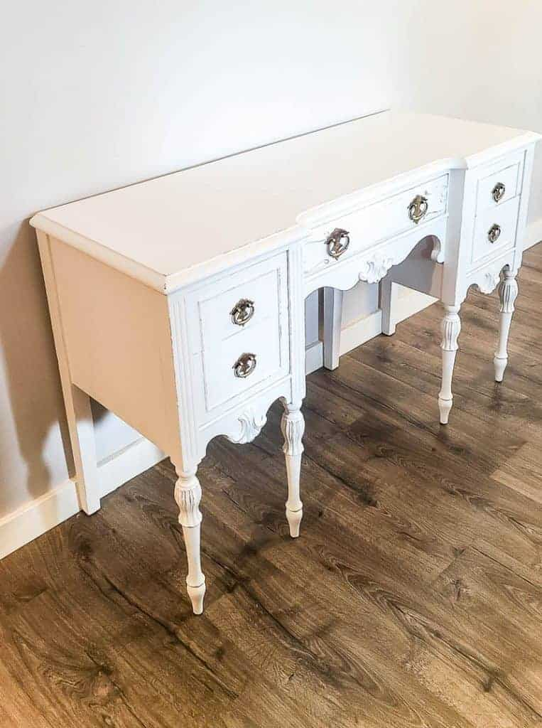 shows the full view of the white vintage chalk paint desk