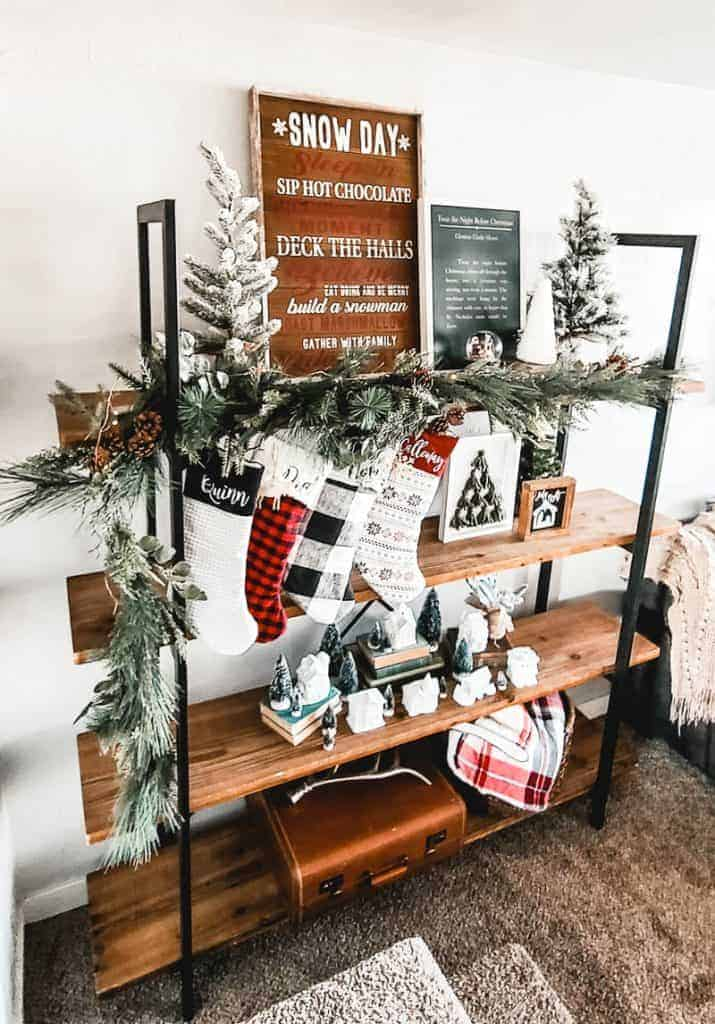 Bookshelf with Christmas decorations in living room