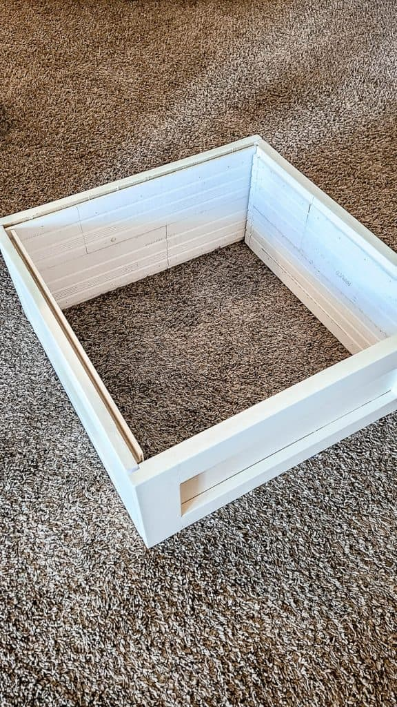 shows the shiplap put together to make the Christmas tree box stand