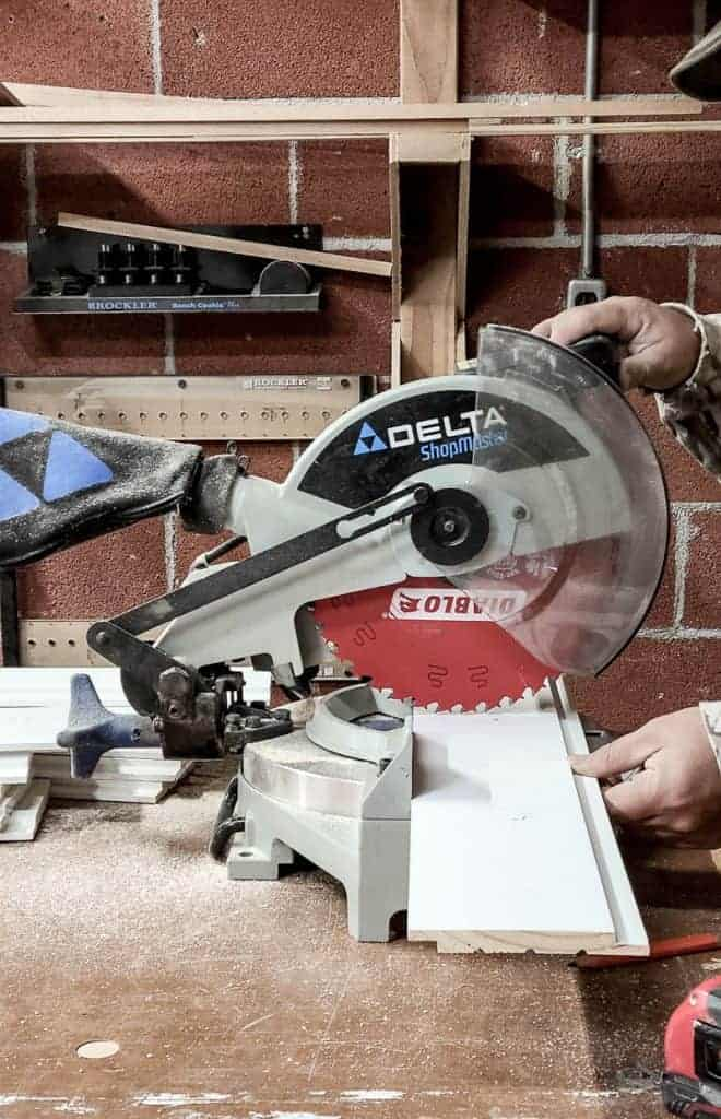 shows a man using a miter saw to cut shiplap