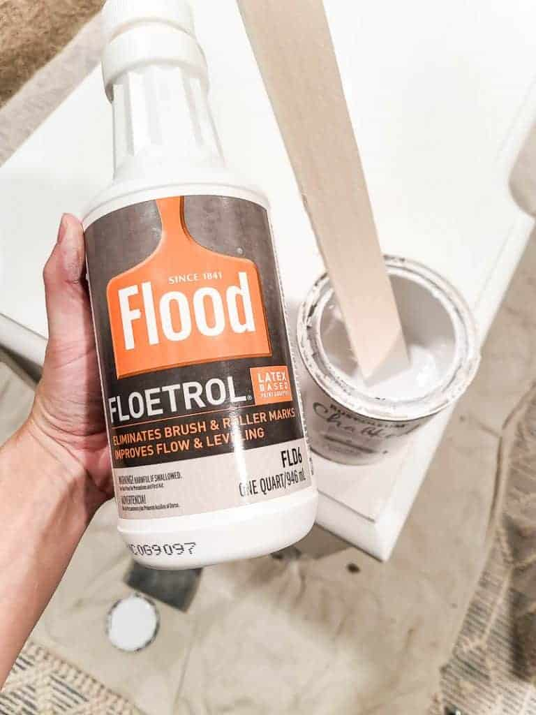 shows Flood paint additive held in woman's hand next to chalk paint
