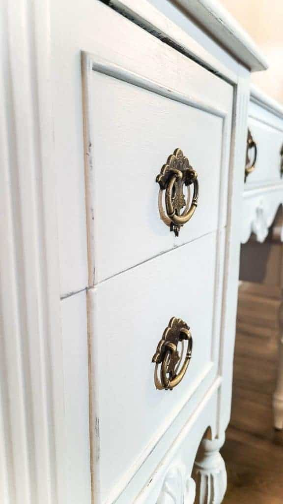 shows an up close view of the drawers on the white desk