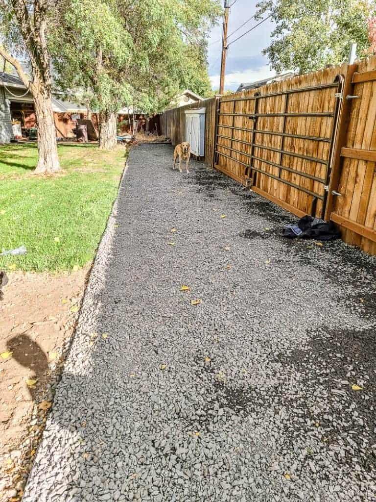 3/4 minus gravel along edge of fence in backyard