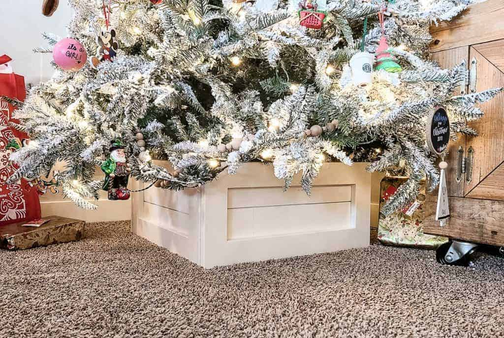 shows the shiplap tree box stand with flocked Christmas tree