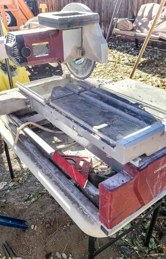 a large tile saw is ready to cut pavers