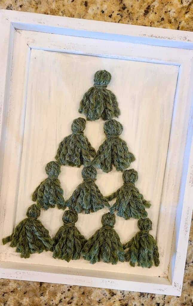 Small green Christmas tree tassels in frame