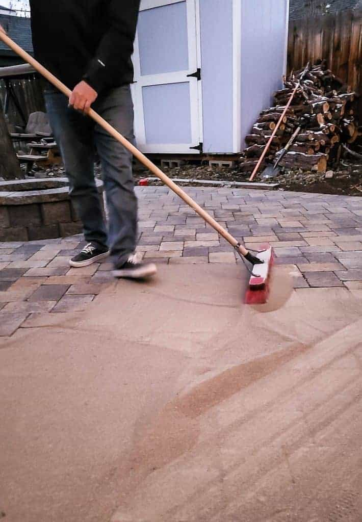 paver sand is swept across the pavers