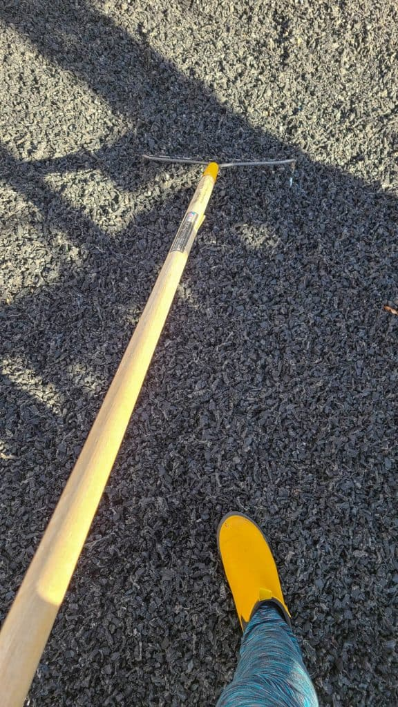 raking rubber mulch flat with garden rake