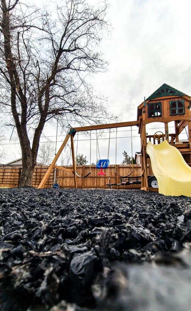 Swing set with black rubber mulch