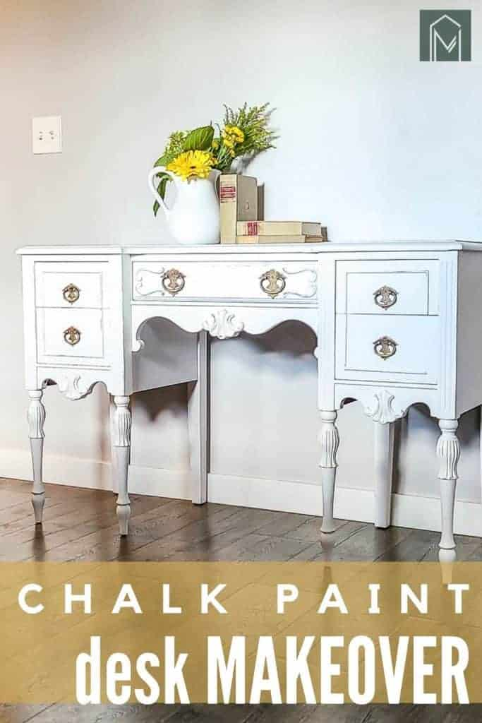 shows a full view of the white desk with flowers and books on it with overlay text that says white chalk paint desk makeover