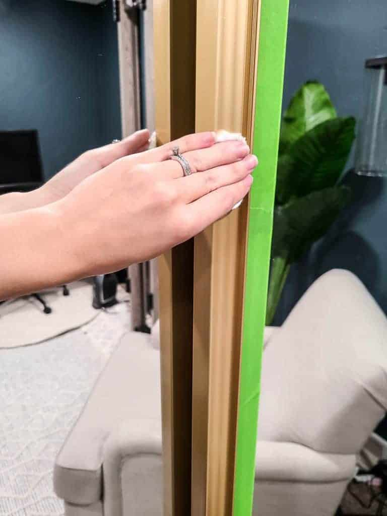 shows a hand wiping the door frame