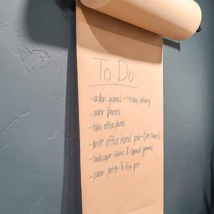 shows the Kraft paper holder mounted on the wall with a to do list on it