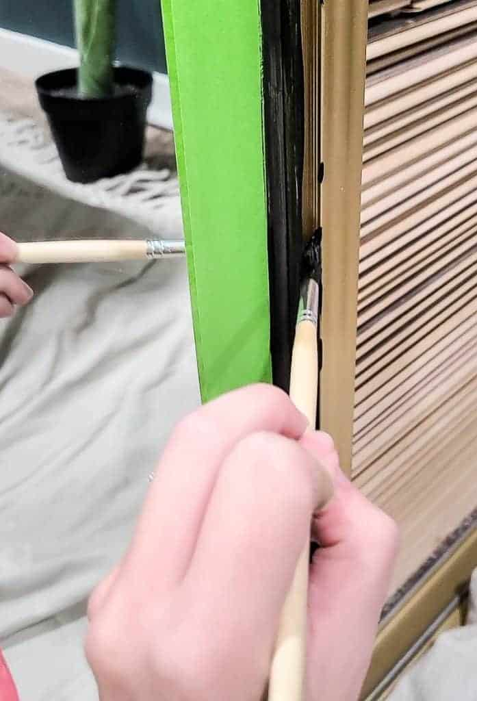 shows the frame being painted black