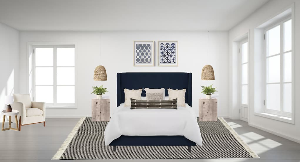 Rendering of master bedroom with dark blue bed frame, gray wood side tables, chevron rug, boho pillows and cream reading chair next to window