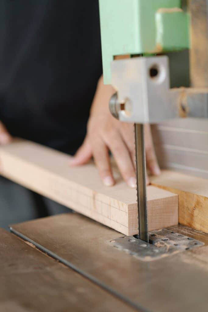shows a band saw cutting a piece of wood