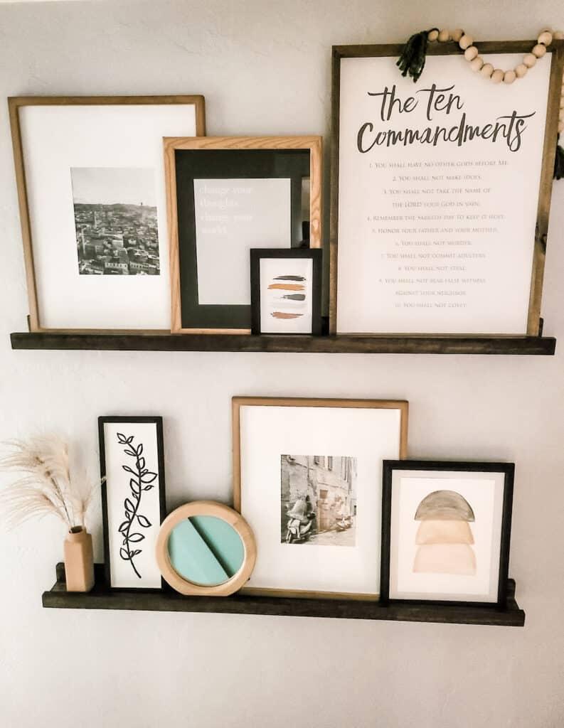 Collage of neutral boho wall art on shelves