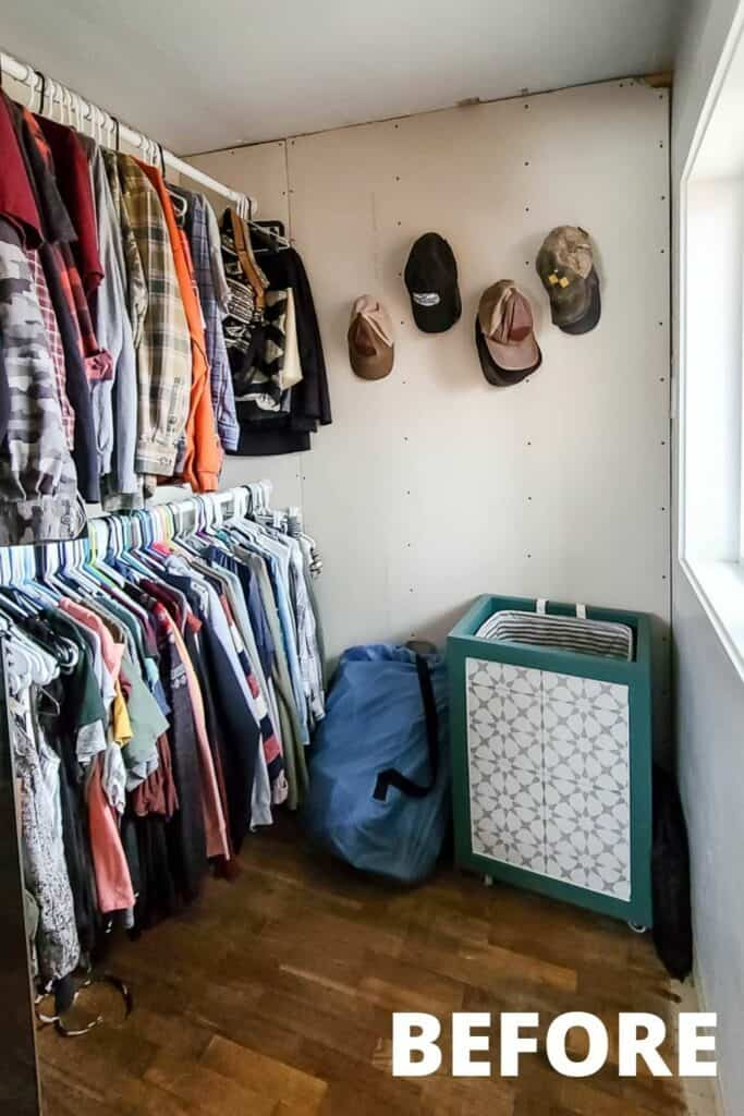 clothes and caps hanging in the small walk in closet before makeover