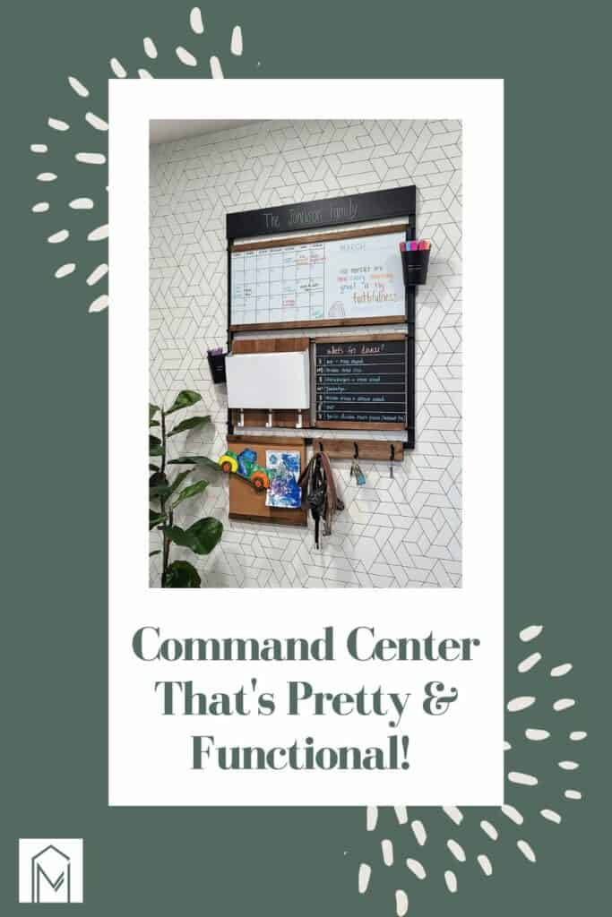 Black metal frame for calendar and paper organization for a family command center on a wall with black and white geometric wallpaper with text overlay that says command center that's pretty and functional!
