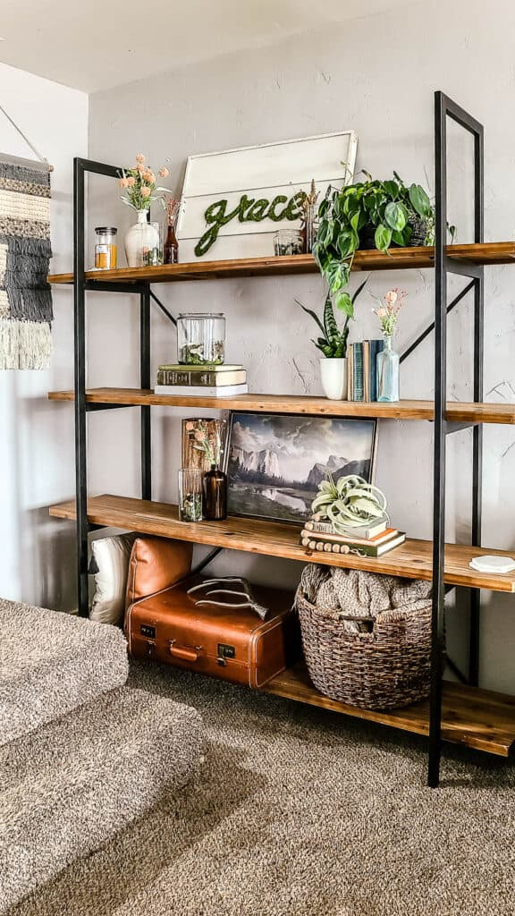 shows a shelving unit in living room with spring decor