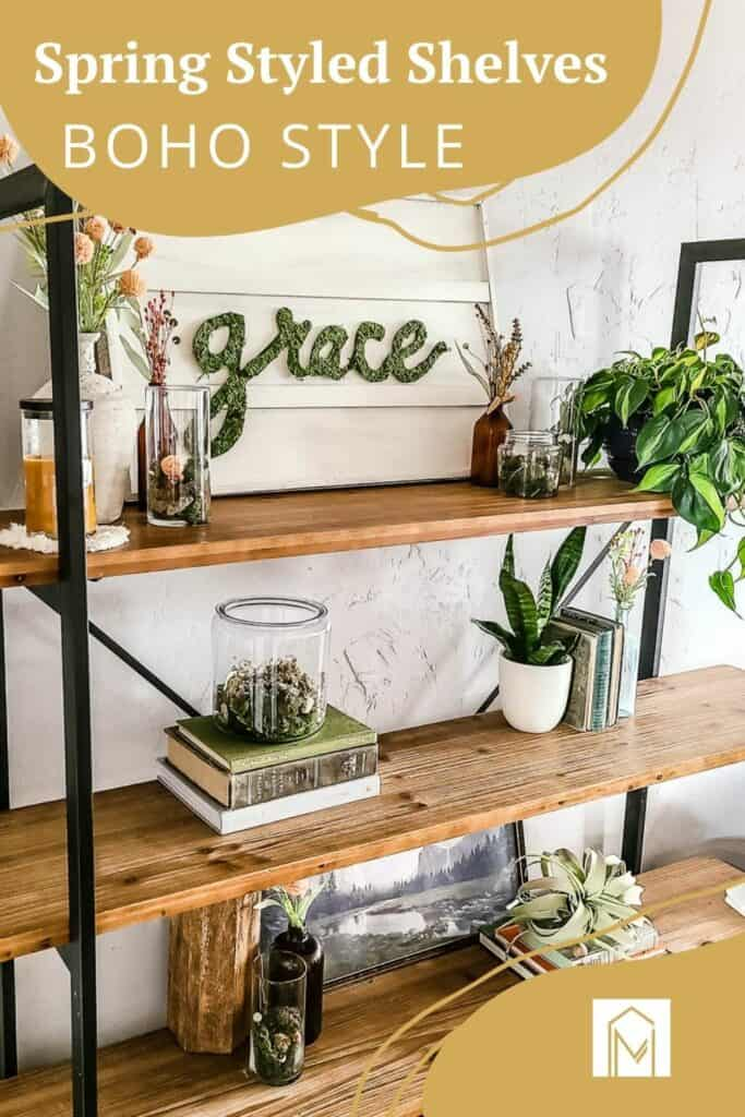 boho styled shelves with moss and books with overlay text that says spring styled shelves boho style